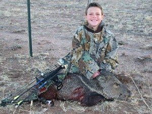 young-hunter-with-a-pig