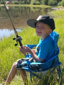 Asher with his fishing gear donated from Bear Miller Outdoors